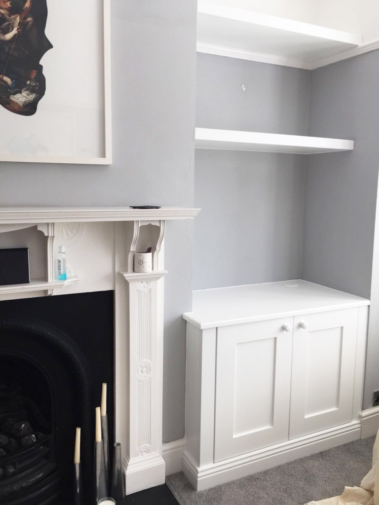 fitted white alcove cupboard and shelf